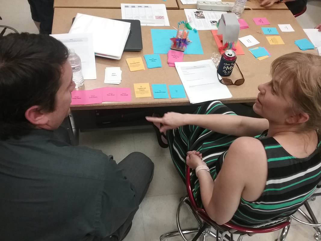 2 high school teachers brainstorm using the maker mockup card game