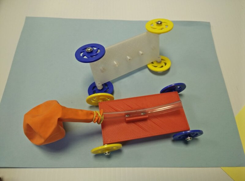 balloon-powered cars built on a chassis of 3-D printed parts