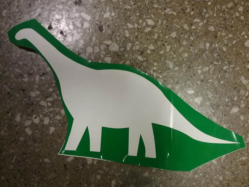 the vinyl outline of an apatosaurus-shaped sticker