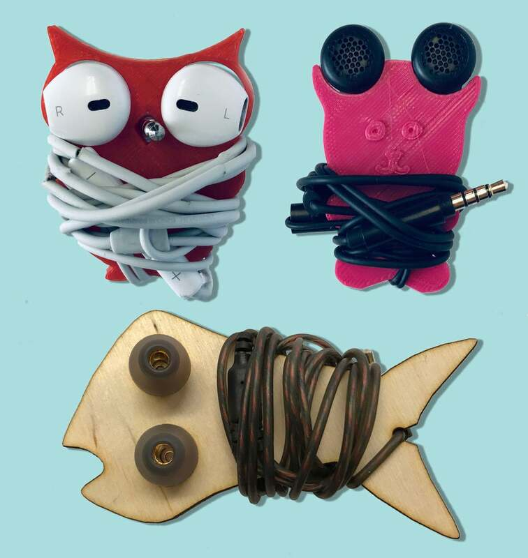 3D printed and laser-cut earbud holders in a variety of animal shapes