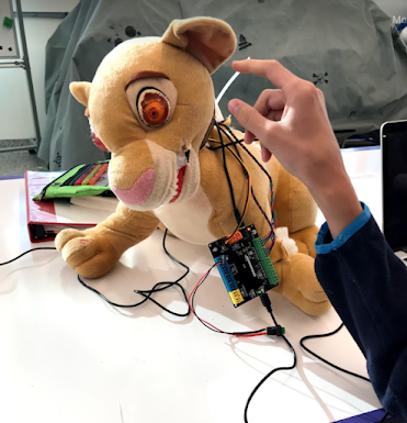 a Simba plush toy modified with electronics