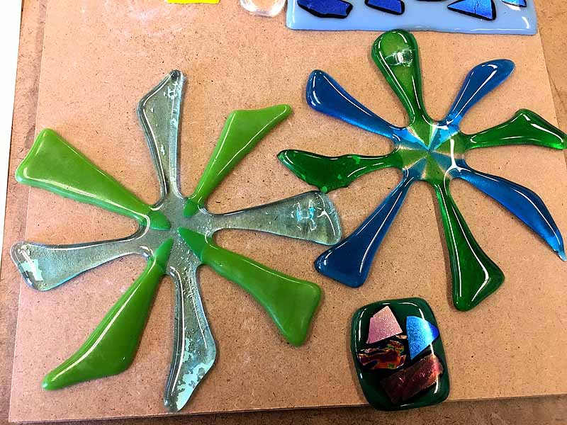 decorate pinwheel sculptures and oblong pendant made of glass