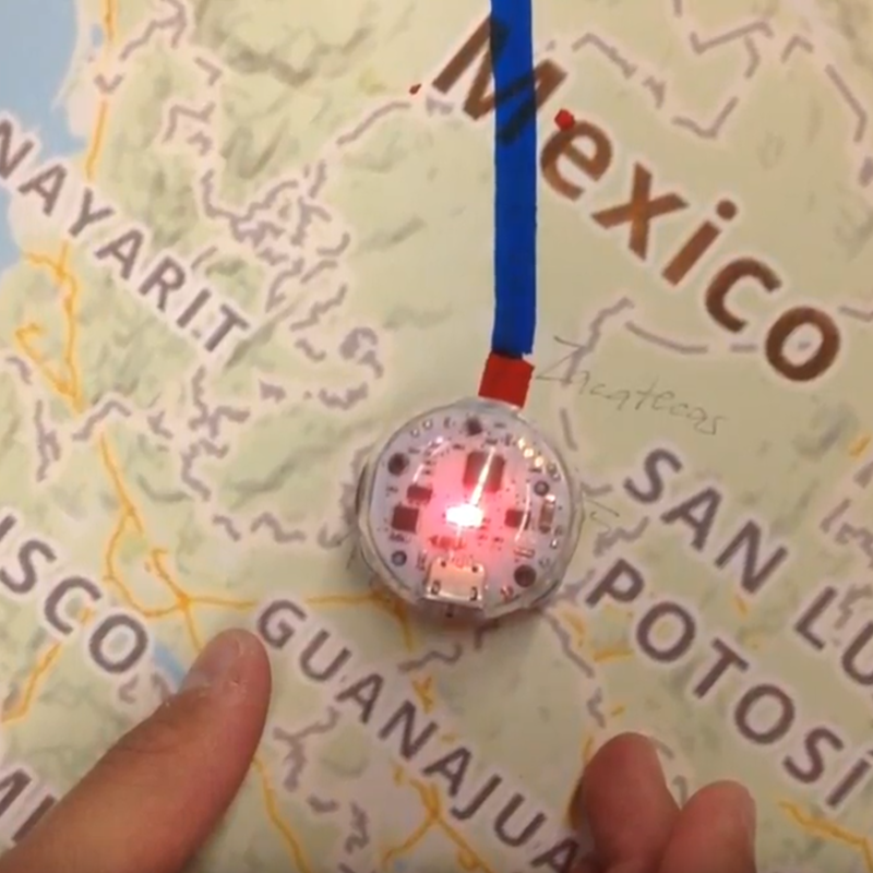 a map of Mexico with a route drawn on, and a small robot glowing at one end of the route line