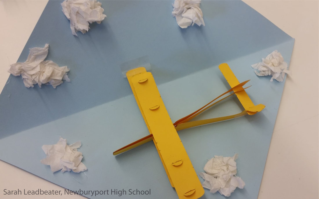 a pop-up card showing a cut-paper biplane and clouds made of crumpled tissue paper