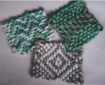 3 woven yarn squares, each with distinctive 2-color patterns